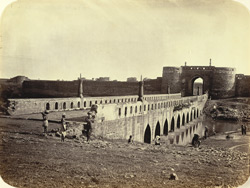 [View of the bridge leading to Asaf Jah's fort, Ajanta.]